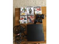 PlayStation 3 slim with 5 games for sale