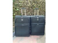 Two Large unused lightweight suitcases