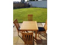 *****SOLD***4 Leather seated Dining Table chairs with extendable oak table. All in great condition.