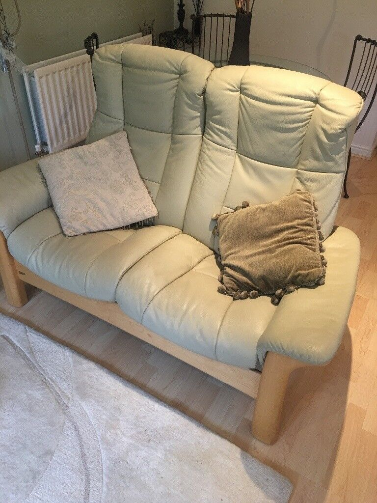 Beige, Leather reclining 2 seat sofa.
