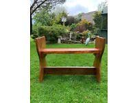 Handmade wooden brown garden seat rather unusual