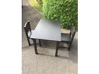 Small black IKEA table and 2 chairs