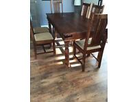 FOR SALE: Wooden dining room table and 6 chairs