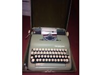 smith corona typewritter 1960's . includes case. never really been used.