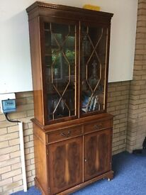 Yew wood dresser - top and bottom are separate. 1 self In closed cupboard, 2 shelves in glass top.