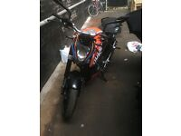 KTM Duke in orange with additional decal kit