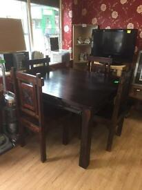 Beautiful dark sold dinning table and 4 chairs