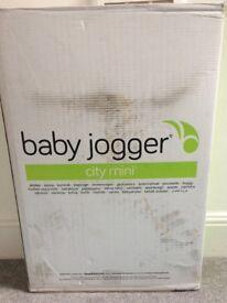 New and unopened Pram: baby jogger city mini