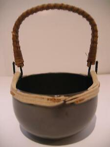 RENATA PODLOG POTTERY BASKET WITH RATTAN HANDLE