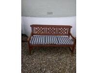 Garden bench with cushion