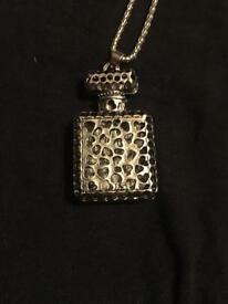Perfume charm on a chain