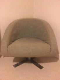 Dwell - Cross base swivelling armchair in mocha, is £599 new.
