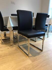 4 dinning chairs and 6 seater glass dinning table