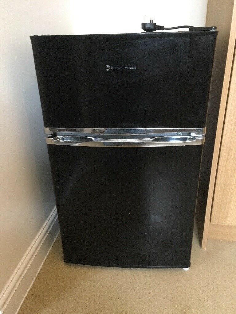 Small black fridge with freezer compartment