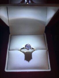 9CT Gold engagement ring with 1CT swarovski zirconia. Never worn, brand new. M1/2 size.