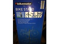 NEW unused bike stand storing up two bicycles