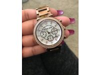 Rose gold Michael Kors watch in box, good condition.