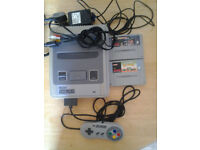 snes with mario alls stars,starwing,controller and cables