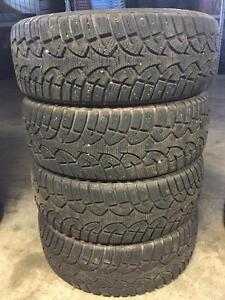 Like new set of 215/60R16 winter tires