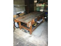 "Wooden workbench with a vice each side. 7'6"" x 3' x 2'9"" high."