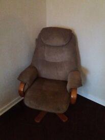 2 single brown fabric swivil chairs