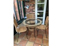 Glass top table and four matching chairs
