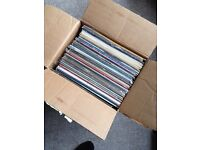 Box of 50 old vinyl records.