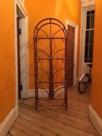 Art Deco style bamboo shelving with glass shelves