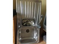 Kitchen sink with one and a half bowl with mixer taps included