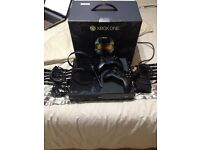 XBOX one console with games two controllers play and charge kit and microphone boxed