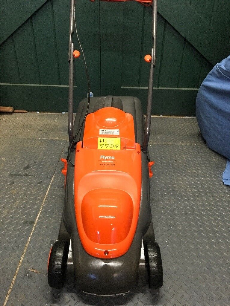 Flymo 320 rotary electric wheeled lawnmower for sale.