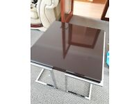 Square coffee table with silver base.