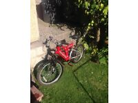 Bicycle childrens red bike with helmet