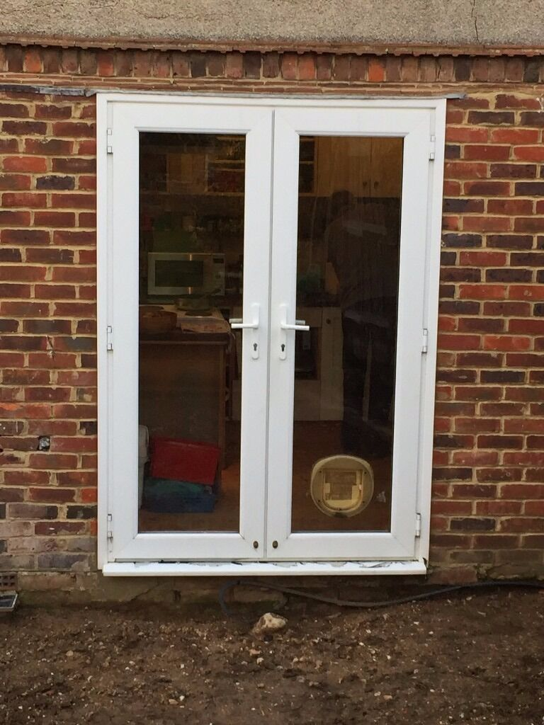 Upvc patio doors with cat flap in shoreham by sea west for Double glazed patio doors sale