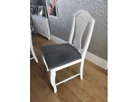 White extending dining table with 6 chairs
