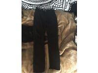 Women's black ripped jeans size 10