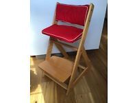 Child sit-right high chair with cusions