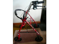 Four wheeled shopping trolley By Drive Medical With seat shopping basket left and right hand brakes