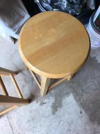 Two wooden bar stools