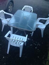 Good heavy glass garden table and 4 chairs bargain