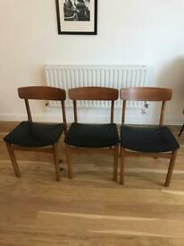 Three vintage mid century designer dining chairs