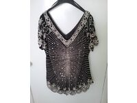 A Chesca sequined top. Size 20. Never worn