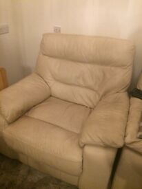 Cream leather reclining armchairs x 2