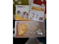 Medela Harmony manual breast pump and feed set
