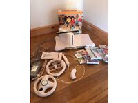 Wifit fit board, console, steering wheels , nunchucks, etc. Used but in good working order