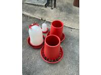3 LARGE CHICKEN FEEDRS AND WATER FEEDER