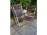 Four slatted metal garden chairs