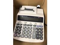 Canon calculator with till roll.