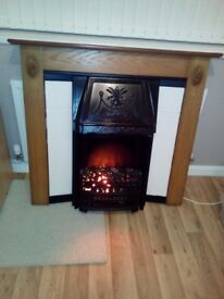 coal effect electric fire with coals, surround and hearth