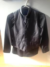 Boys suit. Includes shirt,tie,trousers and waistcoat. Age 10years.